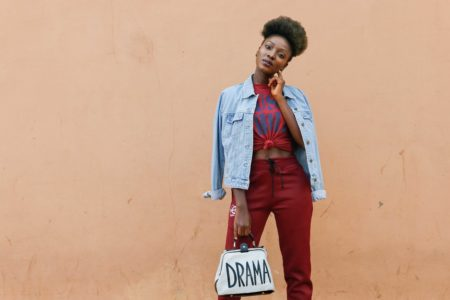 fashion blogger WUMI TUASE styles athleisure trend in burgundy and denim look