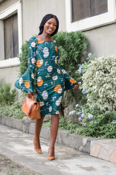 Wumi tuase Nigerian fashion blogger in a green dress Independence Day outfit